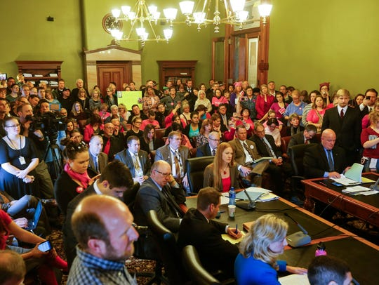 Planned Parenthood supporters and opponents pack a