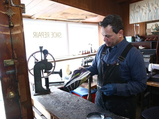 Mark Nelson puts the finishing touches on a custom