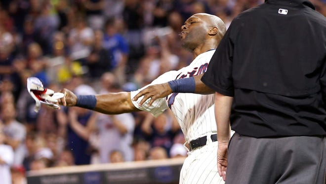 Minnesota Twins outfielder Torii Hunter tosses his glove after he was ejected for arguing a called third strike against the Kansas City Royals on Wednesday, June 10, 2015, in Minneapolis.