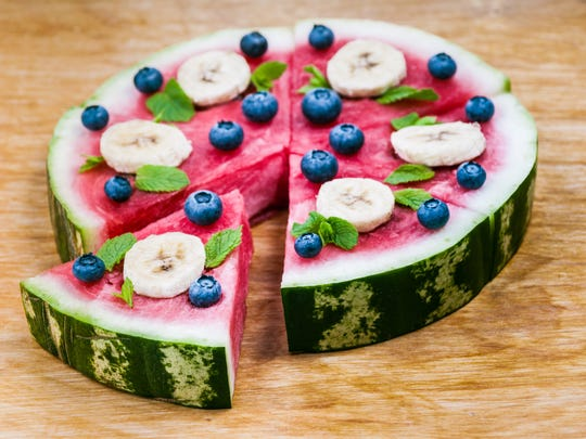 Top watermelon with berries and sliced bananas - you can also add a layer of yogurt to help the toppings stick - for a fun take on fruit salad.