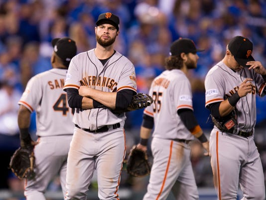 San Francisco Giants first baseman Brandon Belt and his teammates wait during a pitching change in the sixth inning against the Kansas City Royals during Game 2 of baseball's World Series, Wednesday, Oct. 22, 2014, in Kansas City, Mo. (AP Photo/The Sacramento Bee, Paul Kitagaki Jr.)