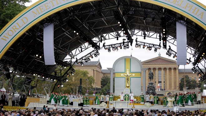 PHILADELPHIA, PA - SEPTEMBER 27:  Pope Francis, lower left, celebrates Sunday Mass at Benjamin Franklin Parkway September 27, 2015 in Philadelphia, Pennsylvania. Pope Francis concludes his tour of the U.S. with events in Philadelphia on Saturday and Sunday.  (Photo by Matt Rourke-Pool/Getty Images)