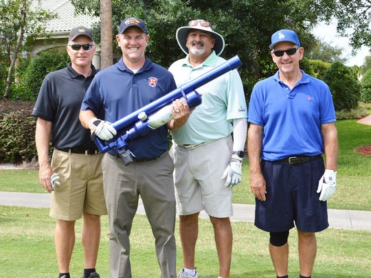 Second Place: Crary Buchanan team members, from left, Gary Fuduloff, Evans Crary, Bob Fletcher and Larry Crary.