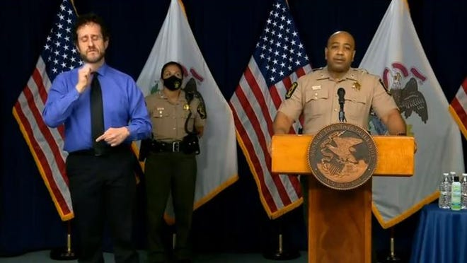"""Lt. Col. David Byrd, Deputy Director of the Illinois State Police, speaks at a news conference about ISP's role in responding to protests over the death of George Floyd, an unarmed black man, who died under a white police officer's knee in Minneapolis last week. Byrd said as a black man, he was hurt by Floyd's death. As an officer, he said he was also """"ashamed"""" when he watched the footage."""