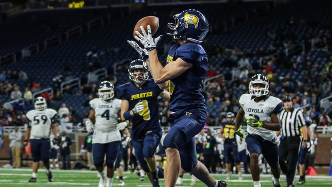 Pewamo-Westphalia's Logan Hengesbach scores a touchdown during the Division 7 high school Championship game against Detroit Loyola on Saturday, Nov. 26, 2016, at Ford Field in Detroit.