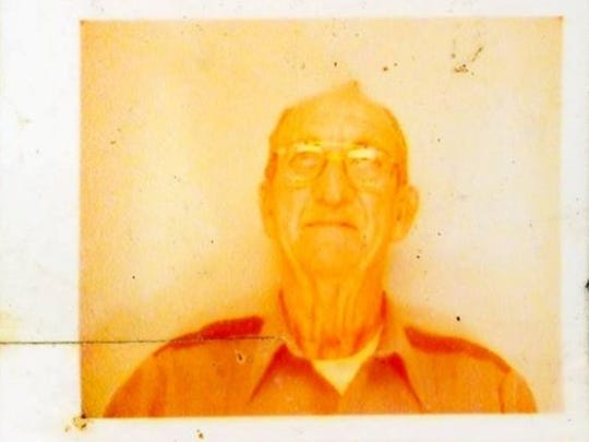 """James Junior Hundley is pictured in a photo taken not long before his death. His eldest son said the photo had baked in the sun. """"He didn't like to have his picture made,"""" his wife said."""