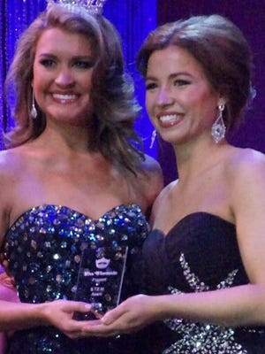 Miss Door County, Hannah Cole, right, receives the STEM Award as a female science role model from Miss Wisconsin 2014 Raeanna Johnson at the 2015 Miss Wisconsin Pageant in Oshkosh.