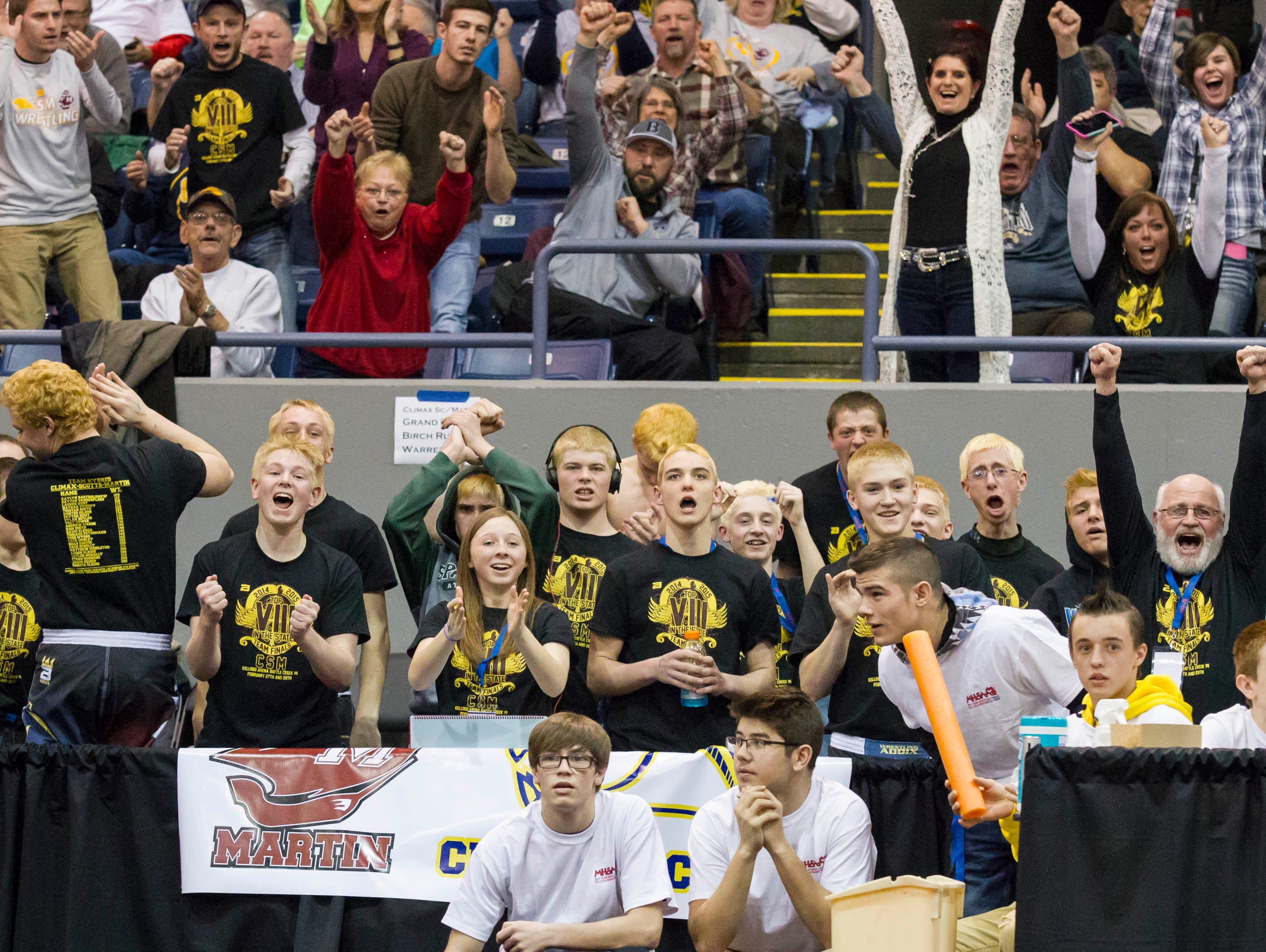 Climax-Scotts/Martin teammates and fans celebrate a pin during last year's team tournament