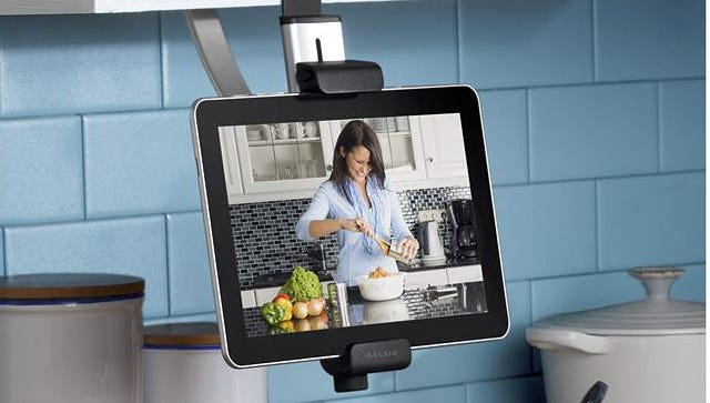 A cabinet-mounted tablet holder made by Belkin.