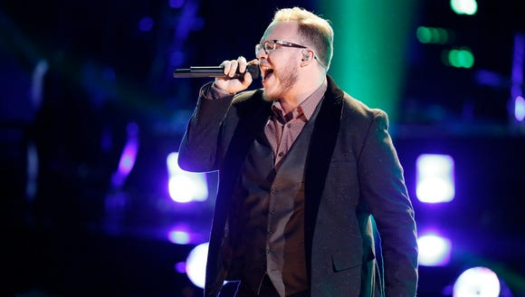 Lucas Holliday singing during the playoff rounds of