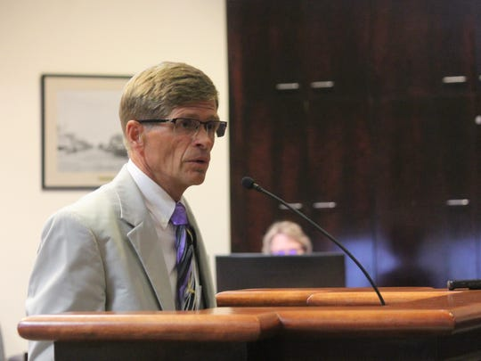 City Attorney Stephen Thies go in front of the City Commission to speak about the RFP addendum.