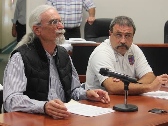 On and off volunteer firefighter Walt Kauffman said he agrees there needs to be rules in place when it comes to any service but the county's policy seems too negative.  County Emergency Services Director Paul Quairoli (left) listens to Kauffman's comments.
