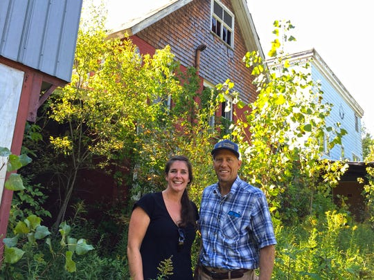 Josi Kytle and Brendan O'Reilly purchased the former Richmond creamery property on Monday. They plan to demolish the dilapidated buildings and build new retail and apartment space.