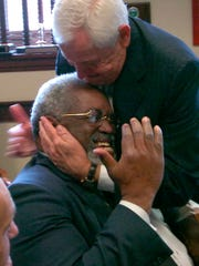 Stan Chesley Cincinnati attorney puts a hug on Leslie Isaiah Gaines in a playful moment while Chesley was making rounds in the Hamilton County Courthouse.