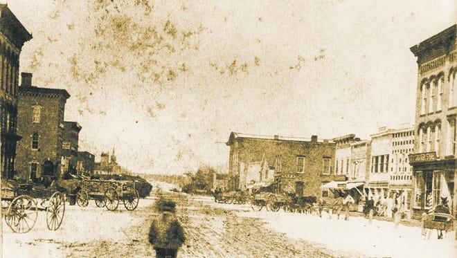 View of South Washington Avenue, 100 block, Lansing, circa 1860.