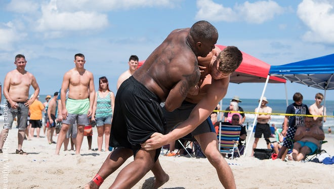 Beach Nationals champion Jacob Kasper of Lexington attacks the legs of runner-up Charles Daniels at Carolina Beach, N.C.