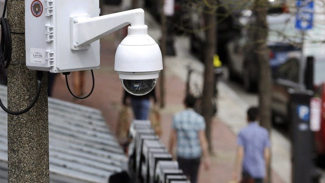 A surveillance camera is attached to a light pole along Boylston Street in Boston. The Boston City Council voted unanimously on Wednesday to pass a ban on the use of facial recognition technology by city government.