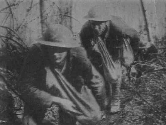 American soldiers in No Man's Land with grenades.