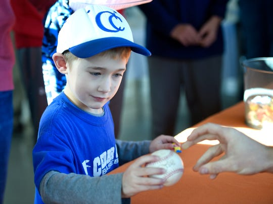 Cedar Crest grad and Houston Astros outfielder Derek Fisher signed autographs and posed with fans for photos at Fairview Golf Course Saturday morning, Dec. 2. Aiden Weikel, 6, gets a baseball autographed during Fisher's appearance.