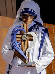 A missionary nun holds the relics of Mother Teresa