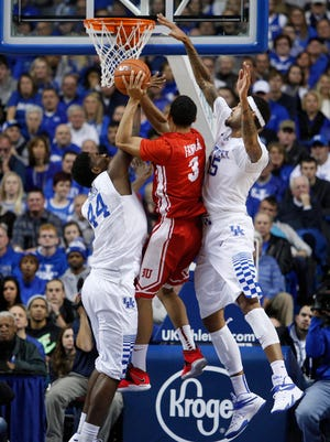 Kentucky forward Willie Cauley-Stein, right, and center Dakari Johnson defend a shot by Boston University guard Eric Fanning in the second half. The University of Kentucky Men's Basketball team hosted Boston University, Friday, Nov. 21, 2014 at Rupp Arena in Lexington. Photo by Jonathan Palmer, Special to the CJ