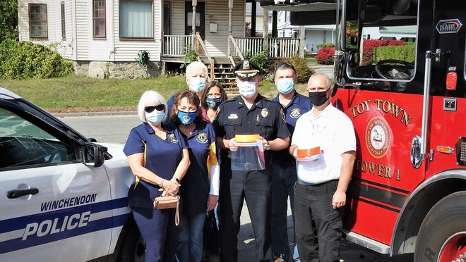 The Winchendon Lions Club donated face masks to the fire department. Shown from left are Viki LaBrack, Cathy Desmarais, Ken LaBrack, Linda Tenney, Police Chief David Walsh, Dan Tenney and Fire Chief Tom Smith.