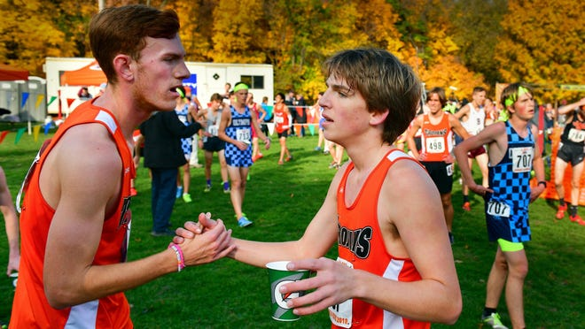 Elmwood/Brimfield runner Luke Hoffmann, right, is the latest in the prolific running family. For 13 consecutive years -- a time frame that has included three state championships and three more runner-up finishes -- a member of the Hoffmann family has competed for the tradition-rich Trojans.