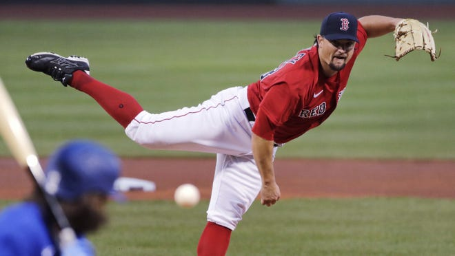 Boston Red Sox pitcher Zack Godley delivers during the first inning of an exhibition baseball game against the Toronto Blue Jays on July 22, 2020 at Fenway Park in Boston.