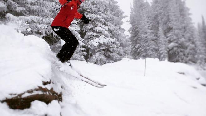 Elsa Roeber, 17, telemark skiing at Vail on a big powder day.