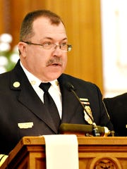 York City Fire Chief David Michaels, left, and Deputy Chief Chad Deardorff commemorate those firefighters who lost their lives in 2015 during the 140th annual York City Firefighters Memorial Service at St. Matthew Evangelical Lutheran Church in York City, Sunday, April 24, 2016. Dawn J. Sagert photo