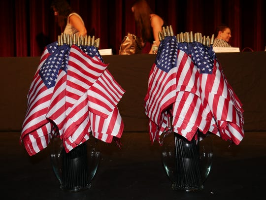 Flags were distributed to new U.S. citizens at a naturalization ceremony Friday in Poughkeepsie.