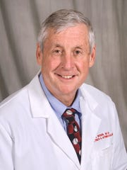 Dr. James Woods, whose Rochester gynecological practice