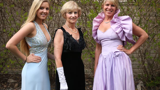 Malorie Harrold, a junior at Waukee High School, stands for a photo in her prom dress with her grandmother, Patty Harrold, center, and Malorie's mother, Kristie Harrold, in the backyard of the Harrold residence in Waukee.