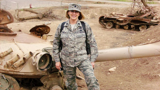 Tami Mielke, a lieutenant colonel in the South Dakota Air National Guard who suffered from PTSD after a deployment in Iraq in 2010, is shown during her deployment. She killed herself on June 24, 2014.