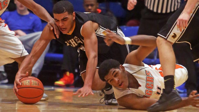Spring Valley's Kai Mitchell, left, and Greece Athena's Anthony Lamb scramble for the ball in the Slam Dunk Tournament championship game Monday at Westchester County Center in White Plains. Greece Athena won 76-58.