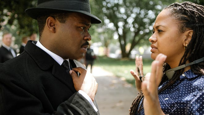 """David Oyelowo as Dr. Martin Luther King, Jr. discusses a scene with Director/Executive Producer Ava DuVernay on the set of the motion picture """"Selma."""""""