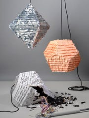 Modern pinatas can be sleek and geometrical for grown-up gatherings, adding pizazz to holidays.