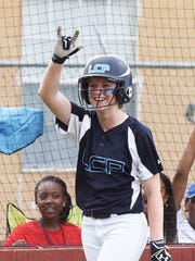 Loyola's Grace Hensley smiles when her team scores during their game against Vanderbilt Catholic in the LHSAA Division II state softball playoff game Friday afternoon.