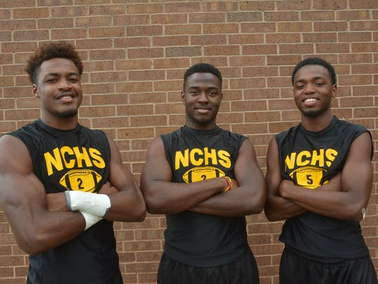Darian Raymond (from left), Chris Reed and Correion Mosby