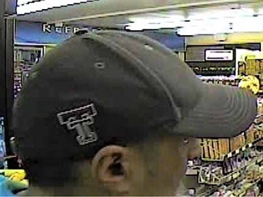 A robbery suspect wore a cap with the Texas Tech logo.