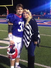 Rivers McGraw poses with his mother, Lauren, after a playoff victory at Jackson Prep in 2014.