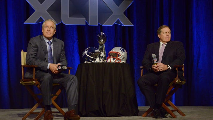 Seattle Seahawks head coach Pete Carroll (left) and