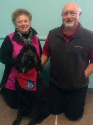 Diane and Michael Miller, along with their therapy dog Driver, are reaching out to those in need in the community.