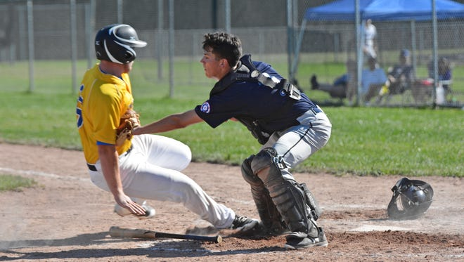 Oconto's Jared Potkay gets tagged out at the plate in the bottom of the sixth inning against The Bays on Saturday in the Oconto Wood Bat Tournament.