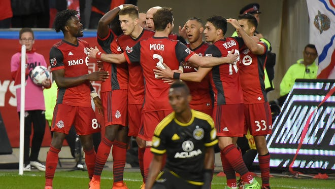 Toronto FC players celebrate a goal by defender Justin Morrow against Columbus Crew at BMO Field.