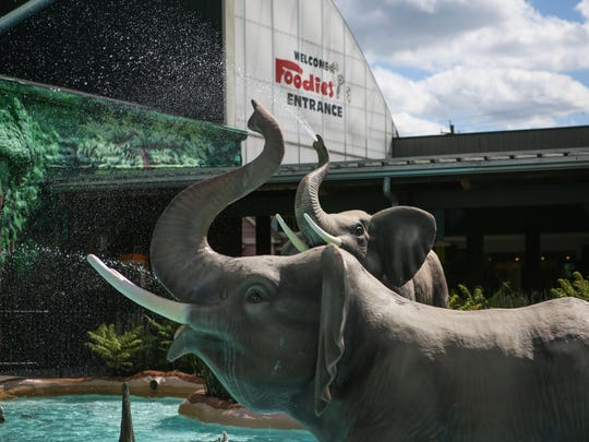 """Elephants greet grocery shoppers outside the main """"foodies"""" entrance of the first location of Jungle Jim's in Fairfield. After its start on Dixie Highway in 1975, Jungle Jim's celebrates its 40 year anniversary."""