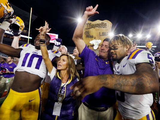 LSU head coach Ed Orgeron celebrates with running back Derrius Guice (5) following their 40-24 win over Mississippi in an NCAA college football game in Oxford, Miss., Saturday, Oct. 21, 2017. (AP Photo/Rogelio V. Solis)
