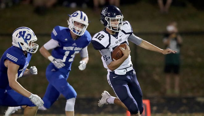 Bay Port's Isaac Krause runs for a long touchdown in the second quarter Friday against Green Bay Notre Dame at Notre Dame Academy.