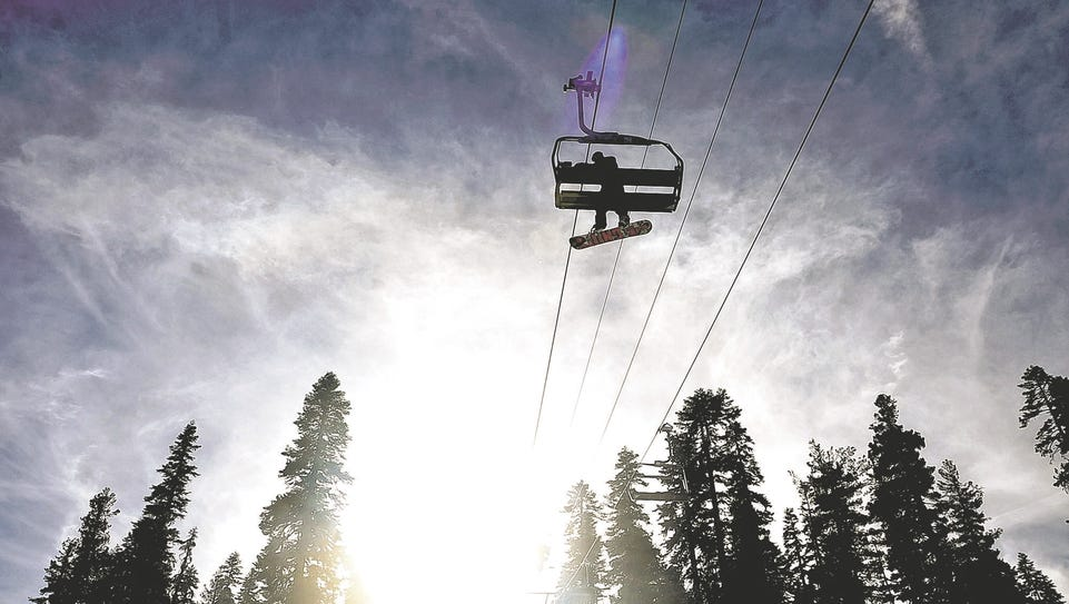 A snowboarder rides on the Comstock Lift at Northstar