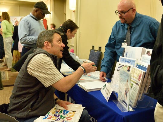 Ron Gold of Lean On We, left, speaks with Michael Ramsaier of Hackensack University Medical Center at the Bergen County Care Fair at the Hilton in Hasbrouck Heights on Sunday.
